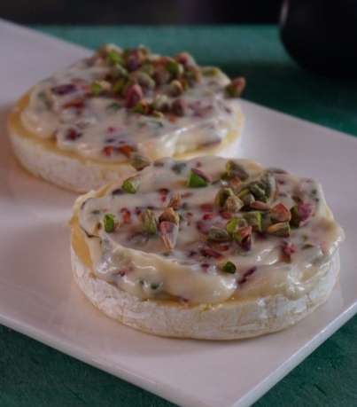 Camembert cheese with pistachios and anardana
