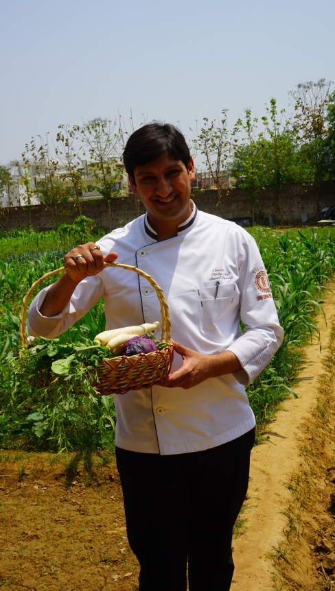 Chef Anand Panwar with a basket of vegetables picked from the farm.