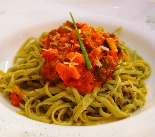 Linguine tossed in cress pesto topped with vegetable caponata