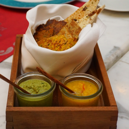Assorted breads with chutneys