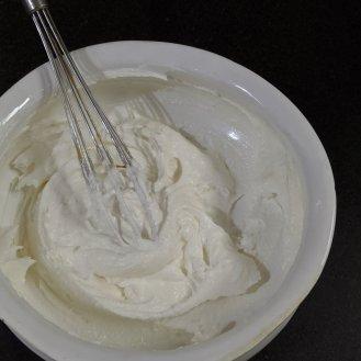 Cream till light and smooth