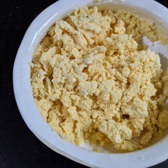Combine ghee and sugar mixture with dry ingredients and then add milk to form a dough