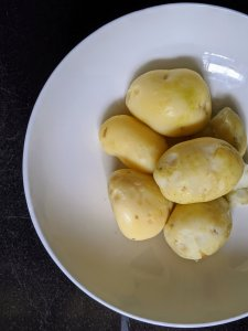 Peel boiled potatoes