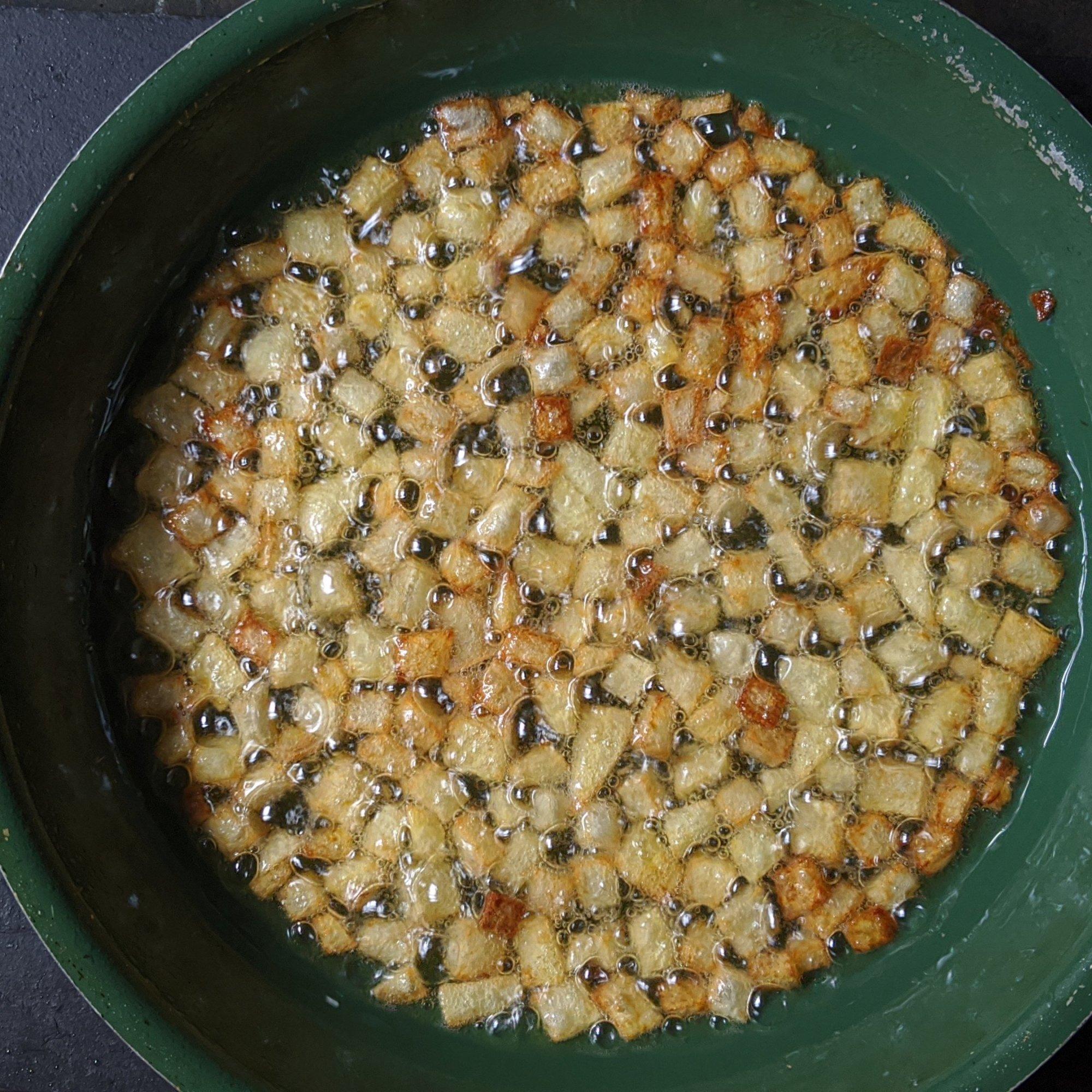 Deep fry diced potatoes